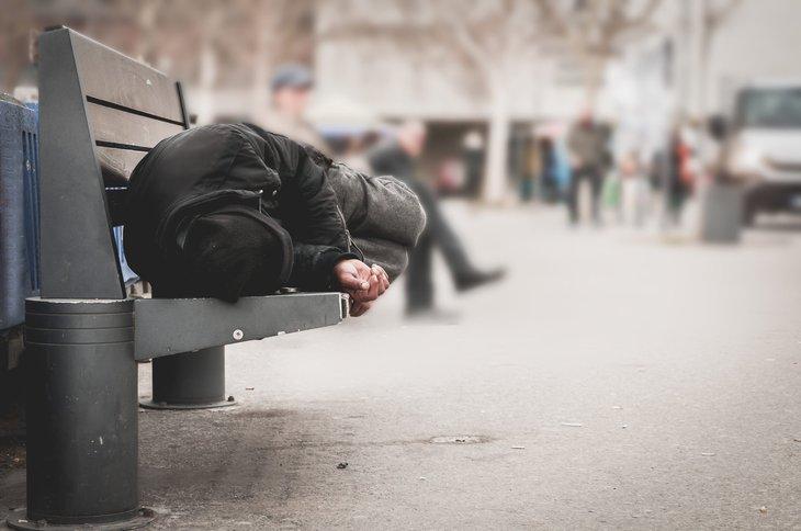 homeless sleeping on bench