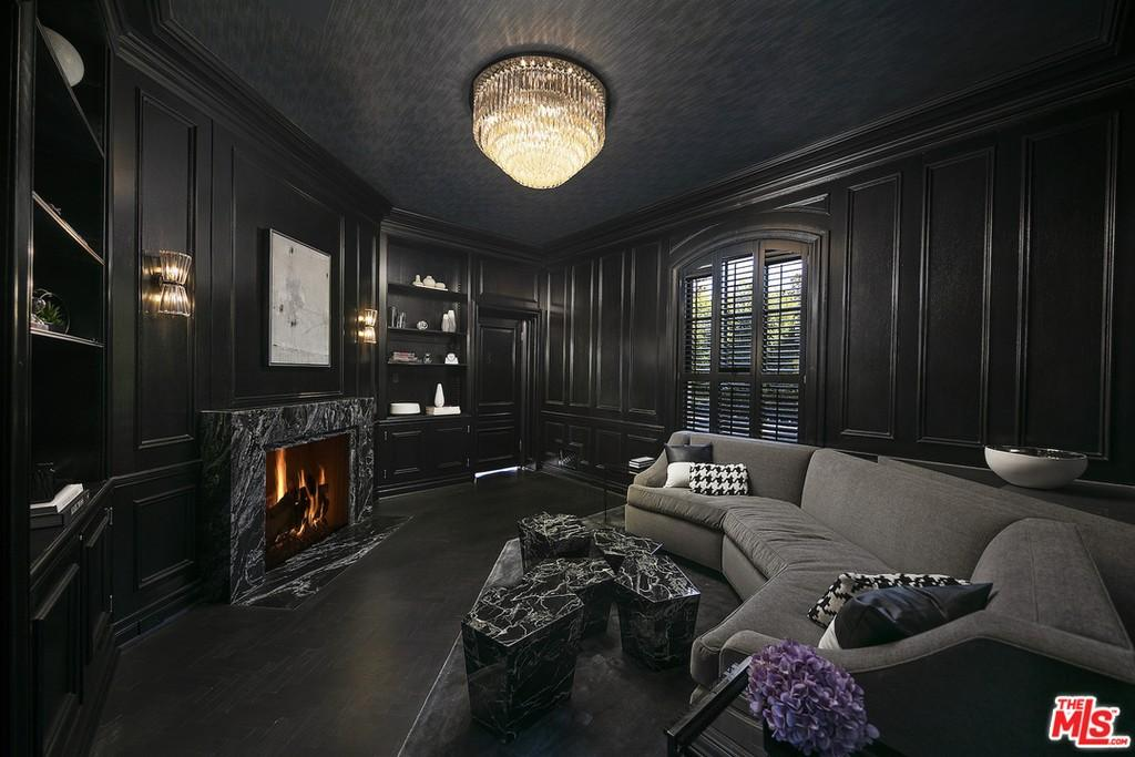 Den with wood paneling