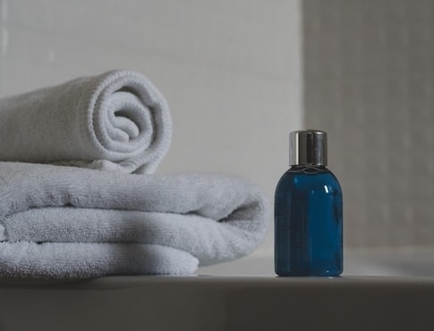 towels and small blue bottle