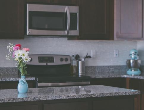 Flower vase on a granite kitchen countertop